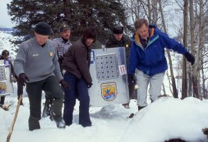 Wolves return to YNP. Left to right, Mike Phillips, Jim Evanoff, Mollie Beattie, Mike Finley, Bruce Babbit. NPS photo by Jim Peaco